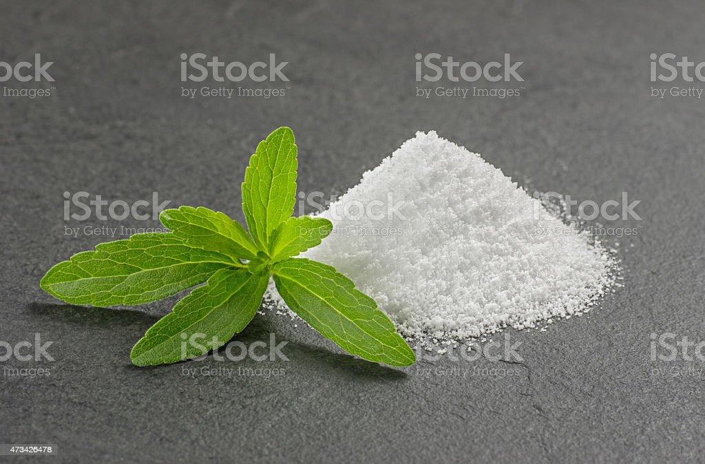 Stevia leaves with stevia powder on a slate plate stock photo