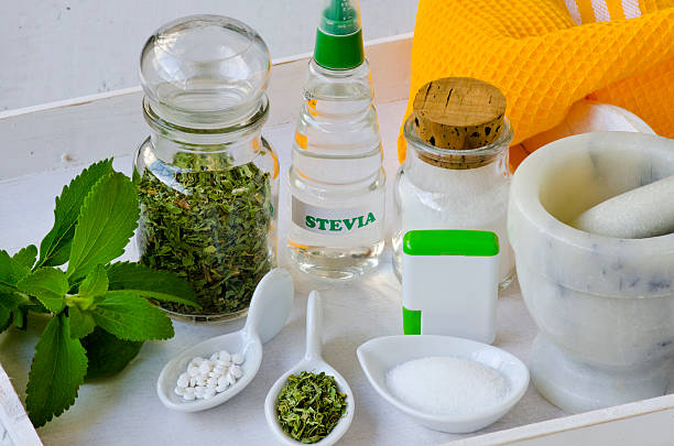 stevia products. natural sweetener. - sweeteners stock photos and pictures