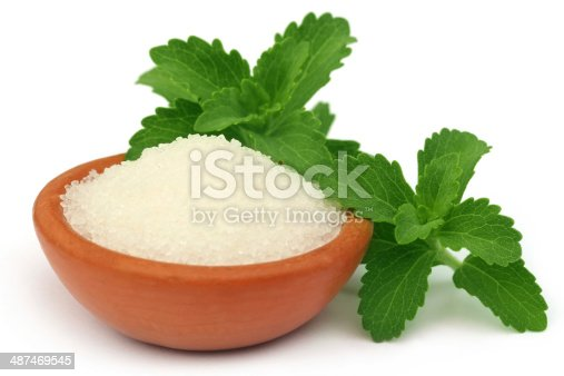 istock Stevia with sugar on a brown bowl 487469545
