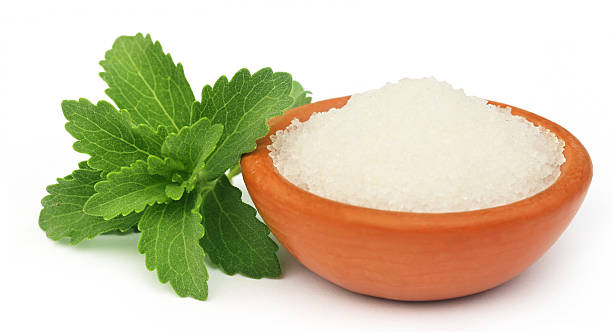 stevia with sugar - sweeteners stock photos and pictures