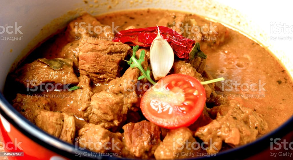 Stew - beef goulash in rustic pot-cruise stock photo