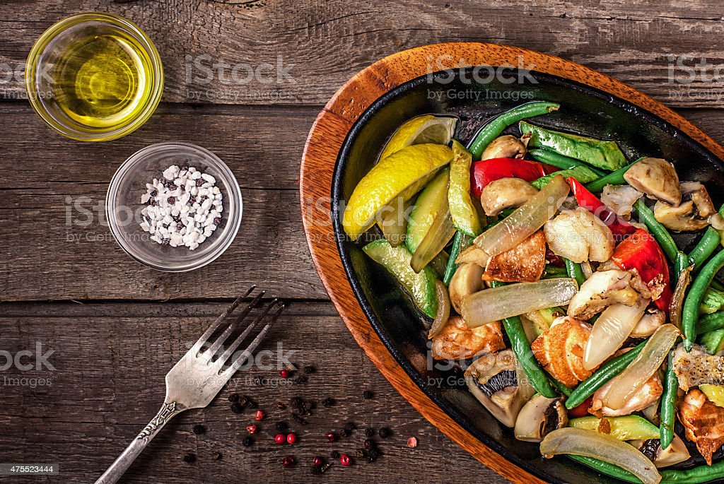 Stew chicken with vegetables and mushrooms stock photo