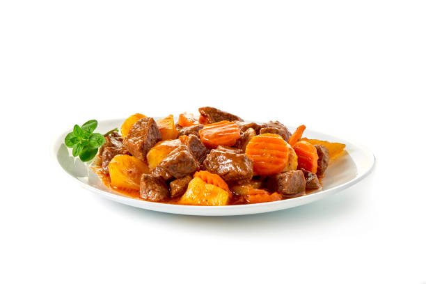 Stew Meat with carrots isolated on white background Stew Meat with carrots isolated on white background beef stew stock pictures, royalty-free photos & images