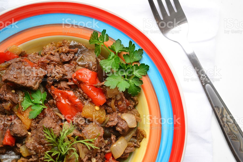 stew of meat and vegetables on colorful plate stock photo
