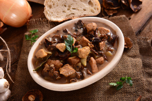 Stew Stew with meat, mushrooms and vegetables goulash stock pictures, royalty-free photos & images