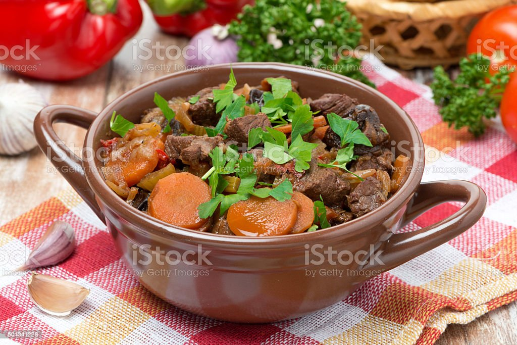 Stew with beef, vegetables and prunes stock photo