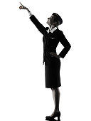 one caucasian Stewardess cabin crew  woman pointing showing isolated on white background in  silhouette