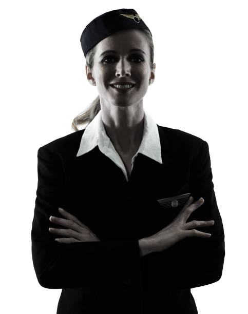 Stewardess cabin crew woman standing silhouette stock photo