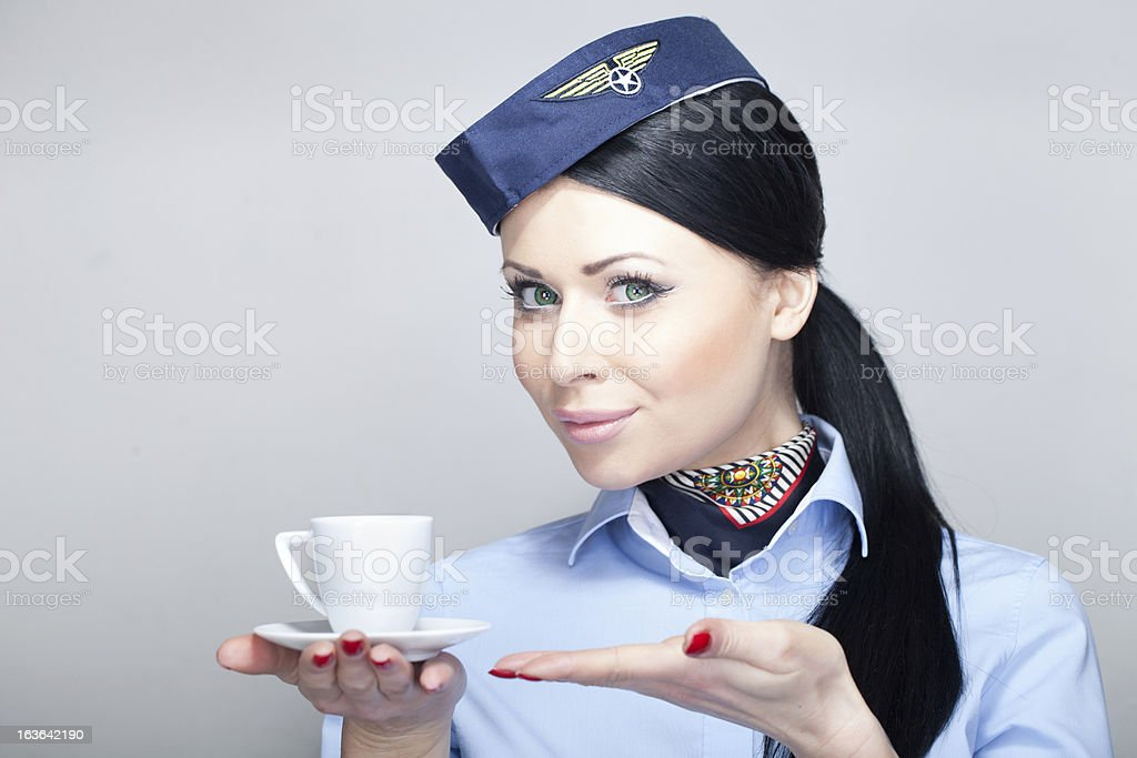 stewardess holding a cup of coffee stock photo