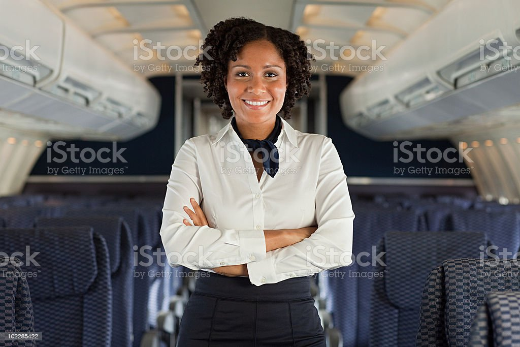 Stewardess on airplane stock photo