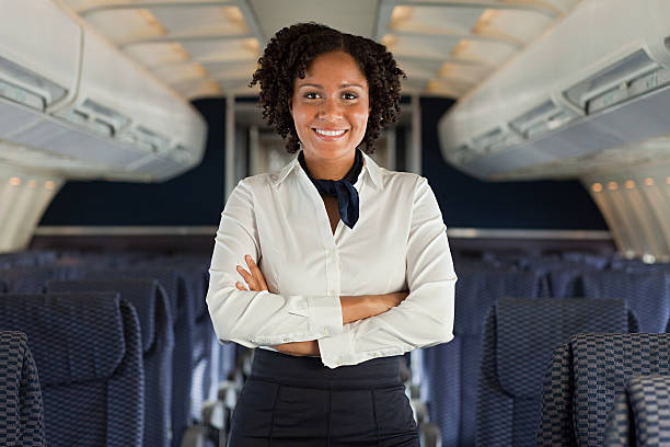 Stewardess on airplane  cabin crew stock pictures, royalty-free photos & images