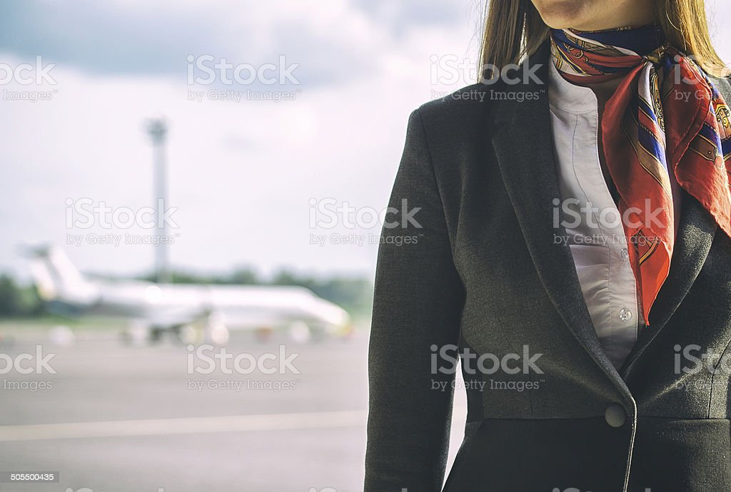 Stewardess on the airfield. Place for your text. stock photo