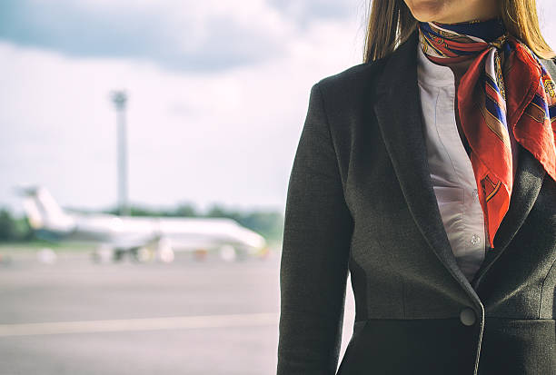 Stewardess on the airfield. Place for your text. Stewardess on the airfield. Place for your text. cabin crew stock pictures, royalty-free photos & images