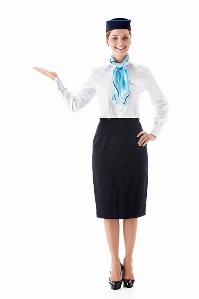 Stewardess A young stewardess on a white background air stewardess stock pictures, royalty-free photos & images