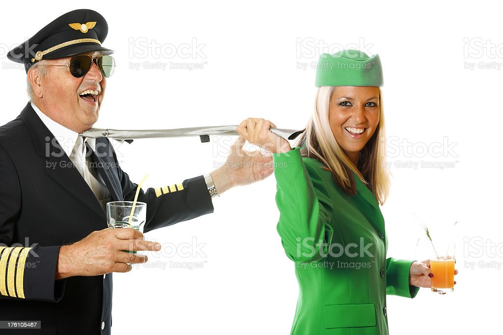 Stewardess pulling pilot for his tie royalty-free stock photo