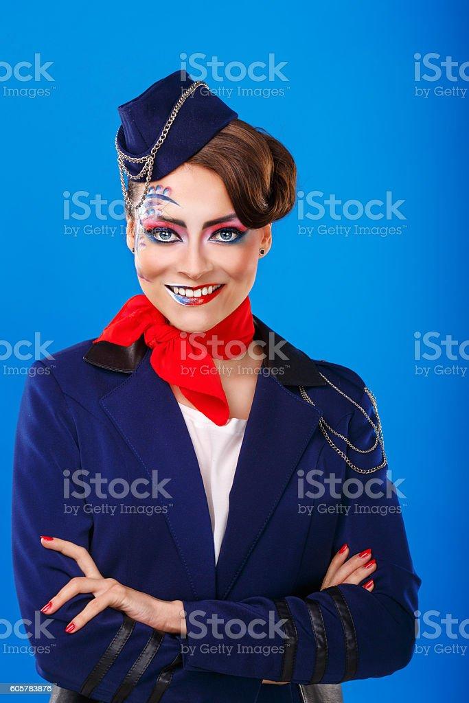 Stewardess with face art meets passengers. – Foto