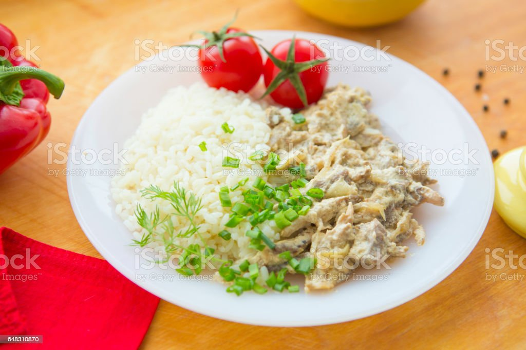 Stewed beef and rice on the white plate. stock photo
