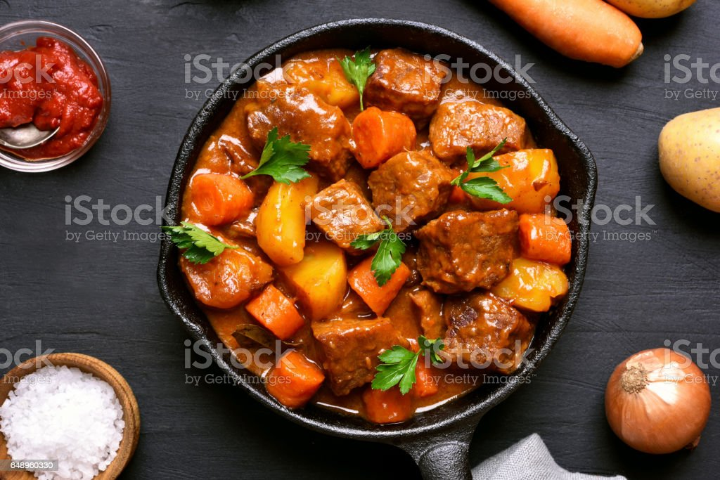 Stewed beef with potatoes and carrots stock photo