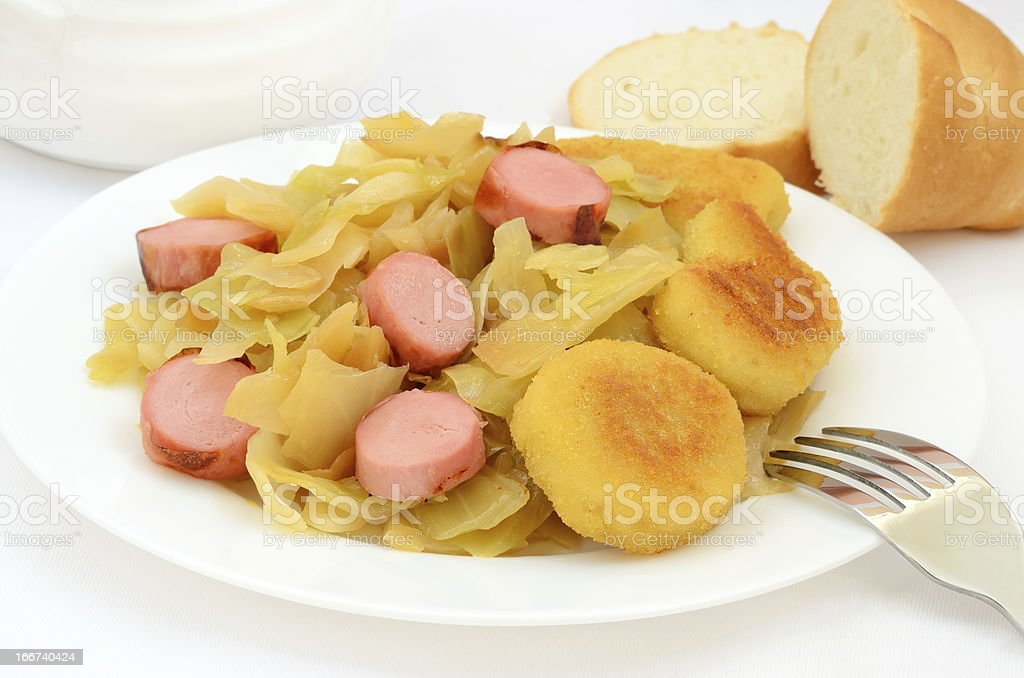 Stewed cabbage with grilled sausage royalty-free stock photo