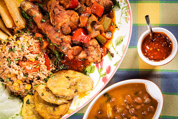 stewed chicken with vegetables and rise - caribbean food stock photos and pictures