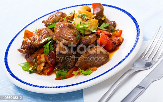 Traditional Bulgarian Kavarma - stewed marinaded meat with vegetables and mushrooms with greens
