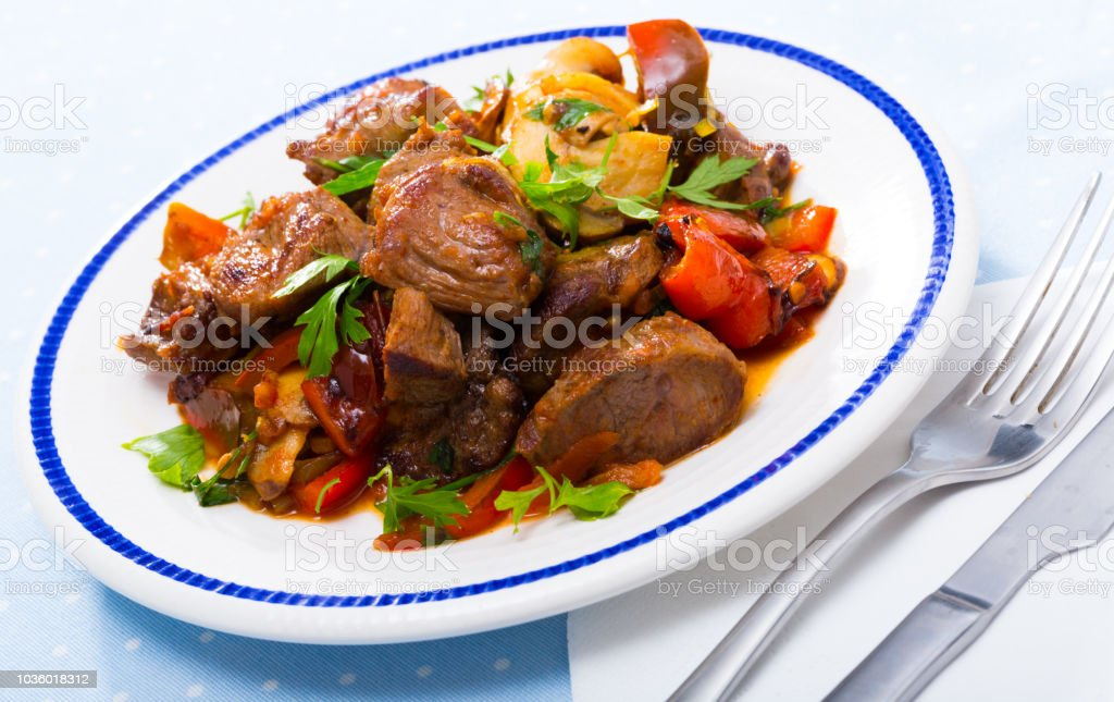 Stewed meat with vegetables and mushrooms stock photo