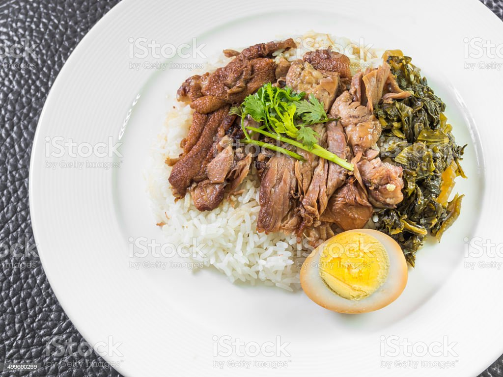 stewed pork leg on rice with boiled egg and preserve stock photo