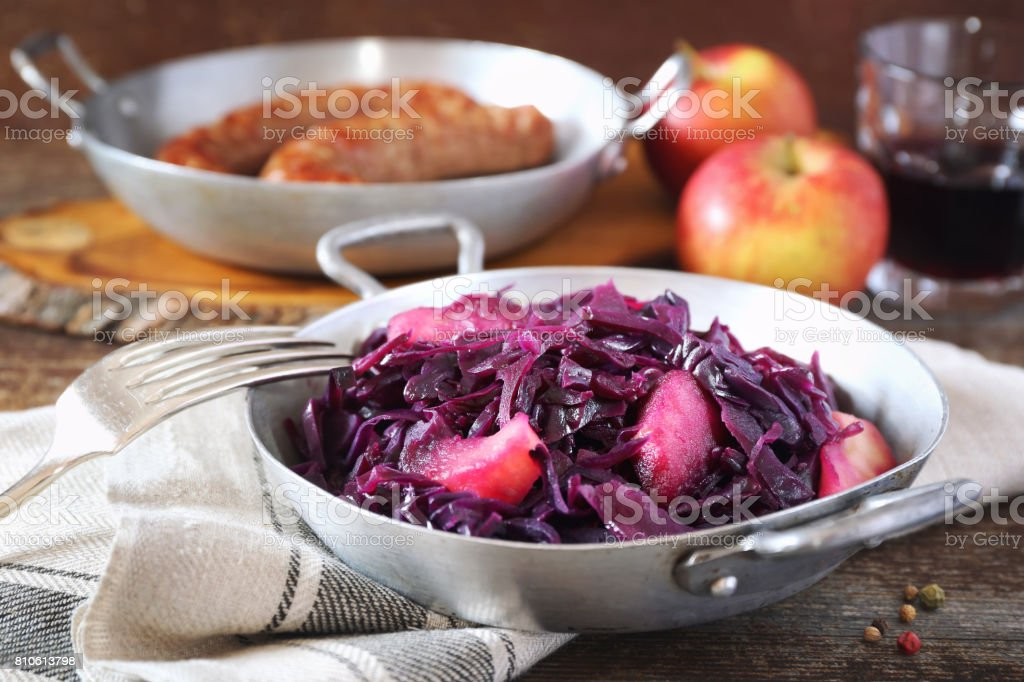 Stewed red cabbage with spices and apples stock photo