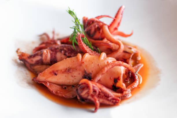 Stewed squid. Italian recipe, Italian cuisine. Stewed squid. Italian recipe, Italian cuisine. cuttlefish stock pictures, royalty-free photos & images