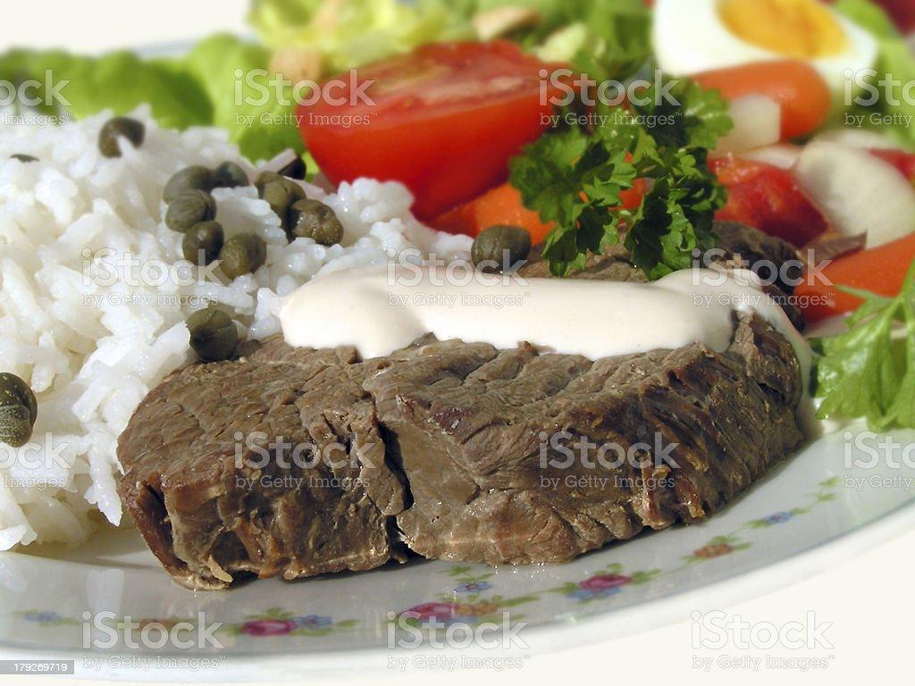 stewed steak with rice and sauce of horseradish -cream royalty-free stock photo