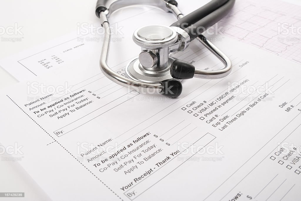 Sthetoscope, EKG and client receipt royalty-free stock photo