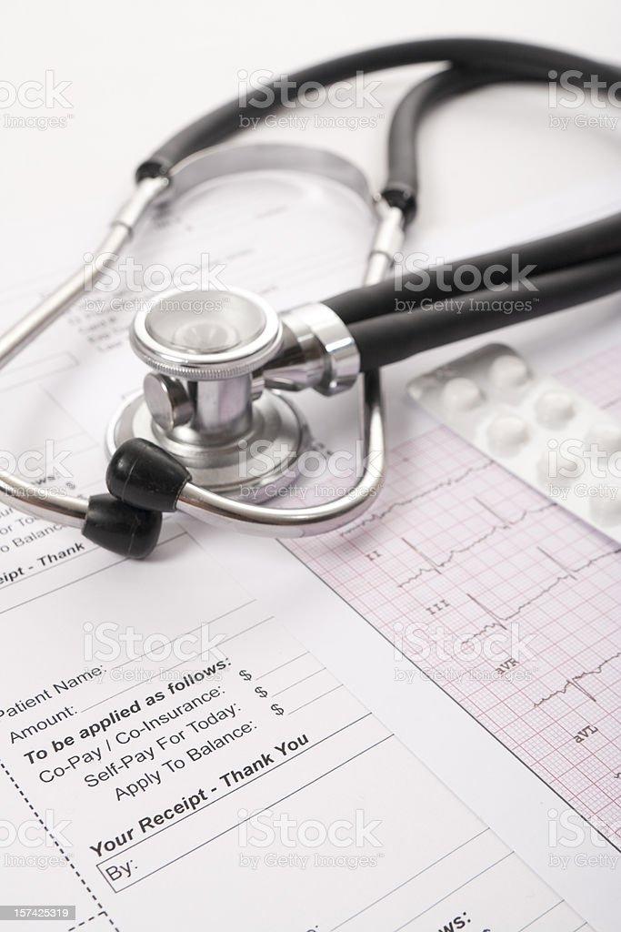 Sthetoscope, EKG, pilss and client receipt royalty-free stock photo