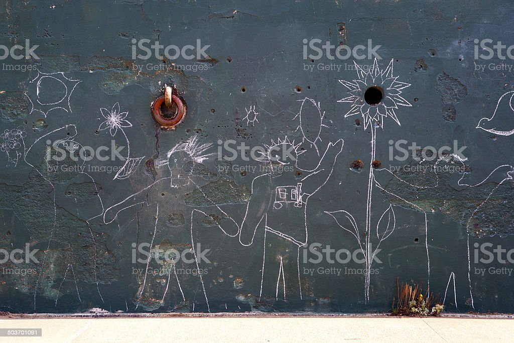 Représentation humaine en traits sur le mur - Photo