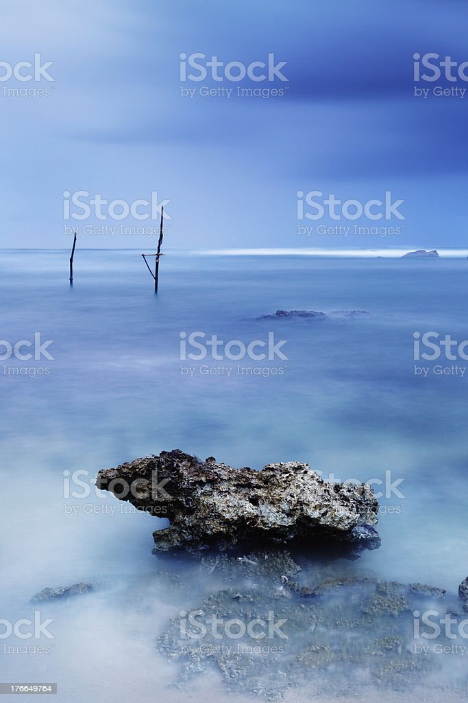 Stick Fishermen in Sri Lanka royalty-free stock photo