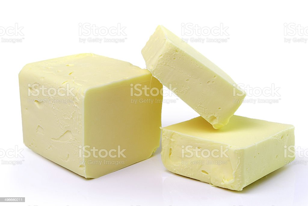 Stick of butter, cut, isolated on white. stock photo