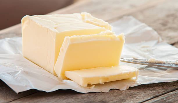 Stick of butter, cut stock photo