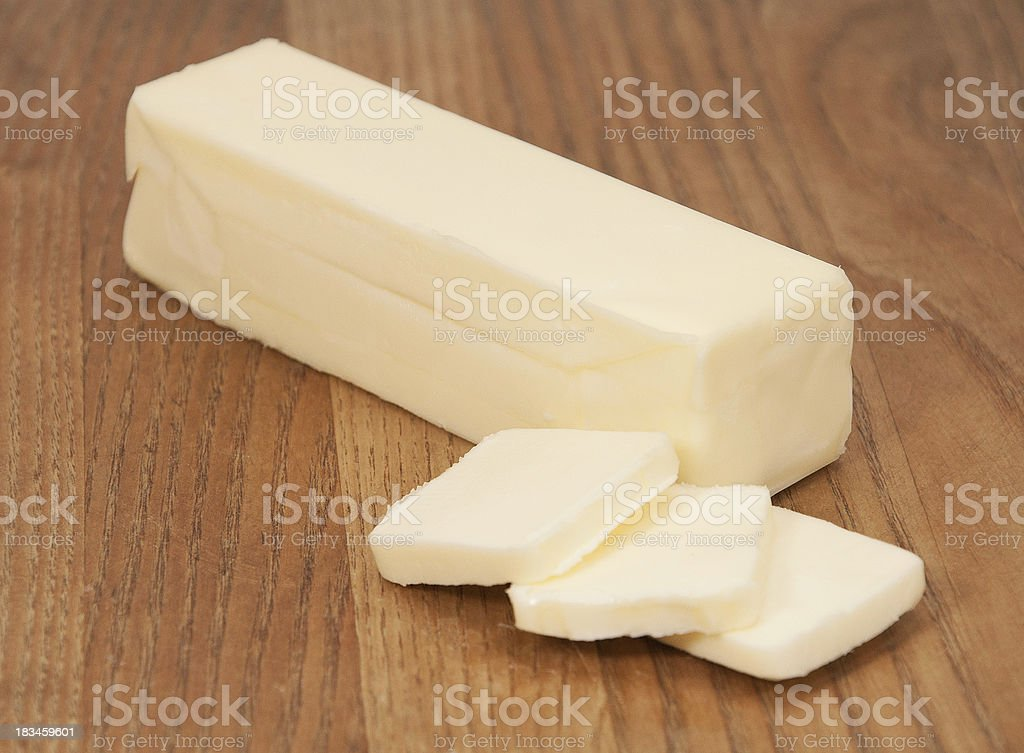 Stick of Butter on Wood Cutting Board stock photo