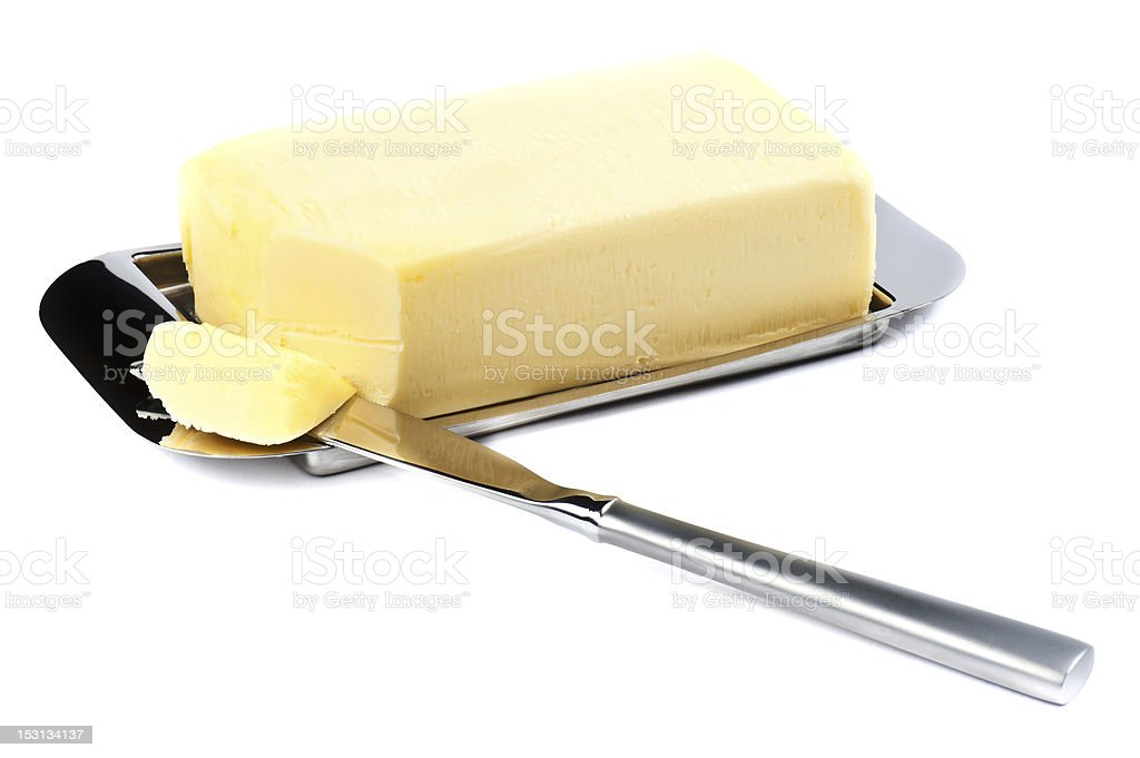 Stick of butter with a corner sliced off Piece of Butter on Silver Plate with Knife. Butter Stock Photo