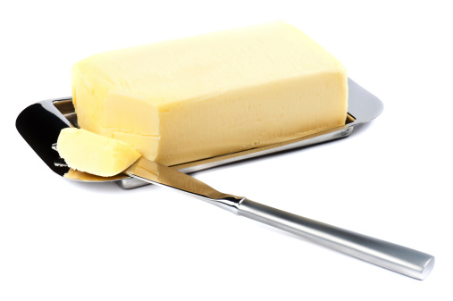 Stick Of Butter With A Corner Sliced Off Stock Photo - Download Image Now