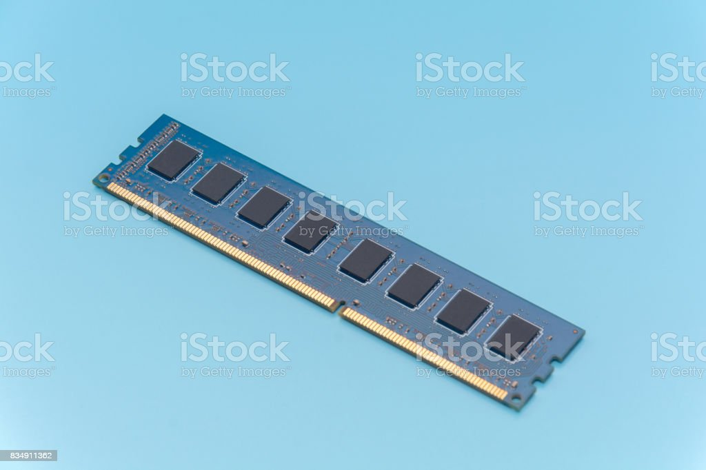 Stick of computer random access memory (RAM) on blue background stock photo