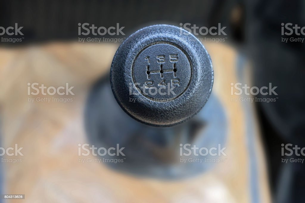 Stick shift with a black head inside auto stock photo