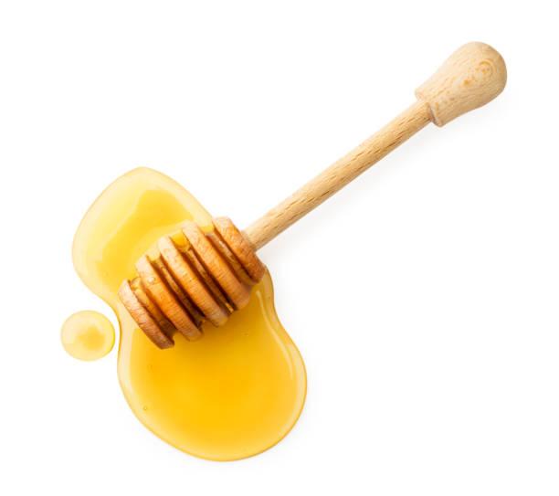 stick with honey on a white background. the view of the top. - mel imagens e fotografias de stock