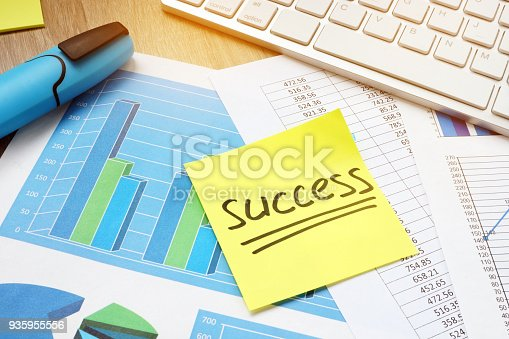 istock Stick with word success and business charts. 935955556