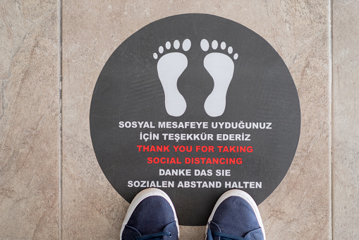 Sticker on floor outside message as part of social distancing measures