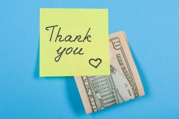 aufkleber mit wort dankeschön und bares geld. - teller kaufen stock-fotos und bilder