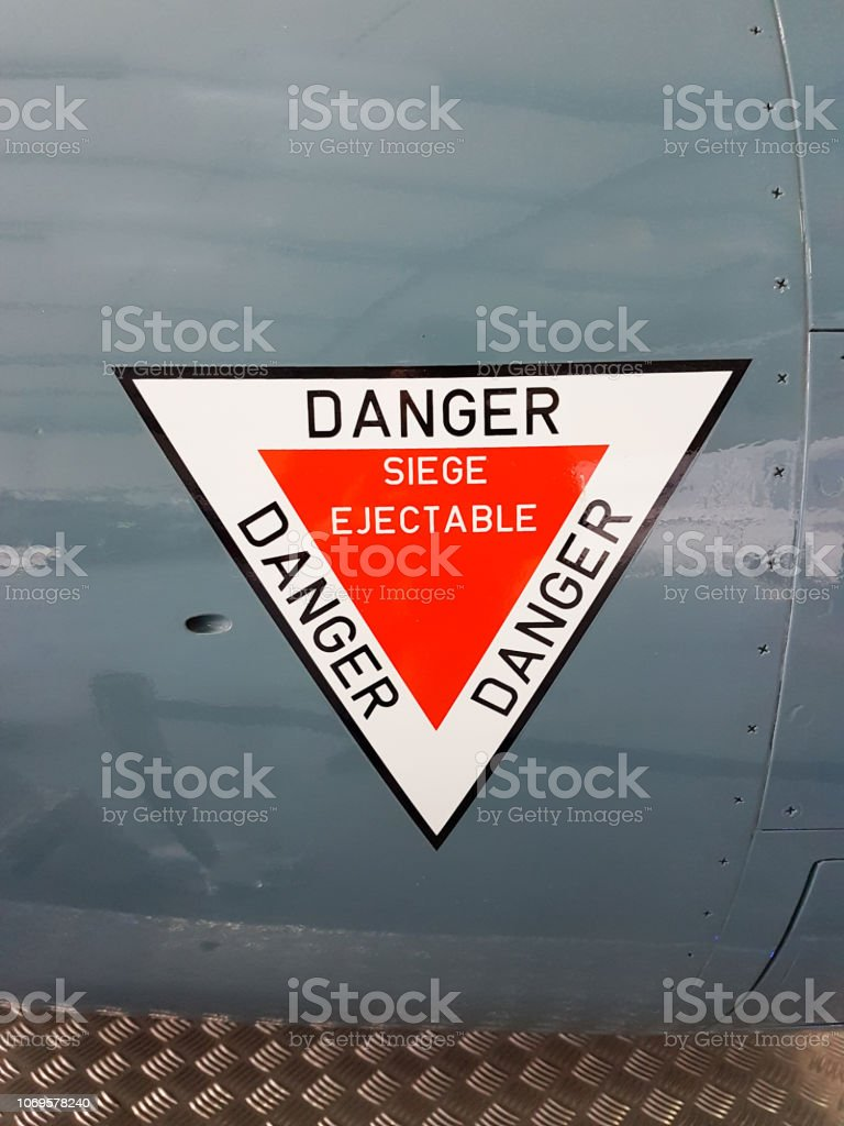 stickers sign on plane write in french siège éjectable danger means...
