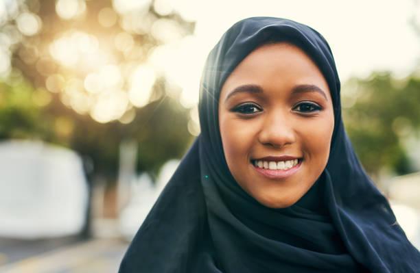 sticking close to our roots - хиджаб стоковые фото и изображения