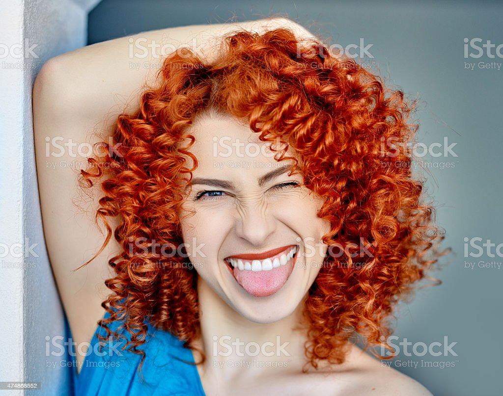 sticking out tongue and laughing stock photo