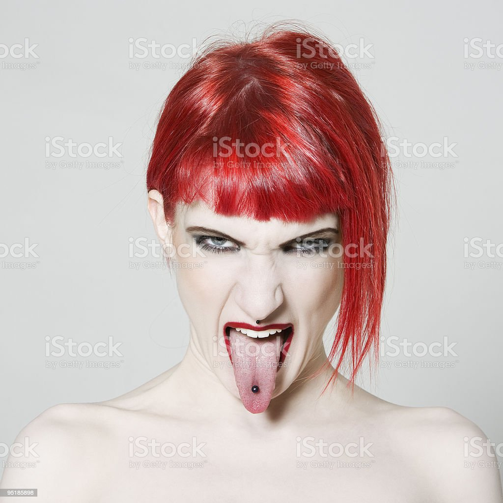 Sticking Out Tongue redhead girl stock photo