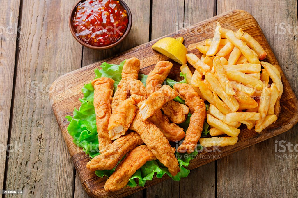 sticks breaded chicken with potatoes stock photo